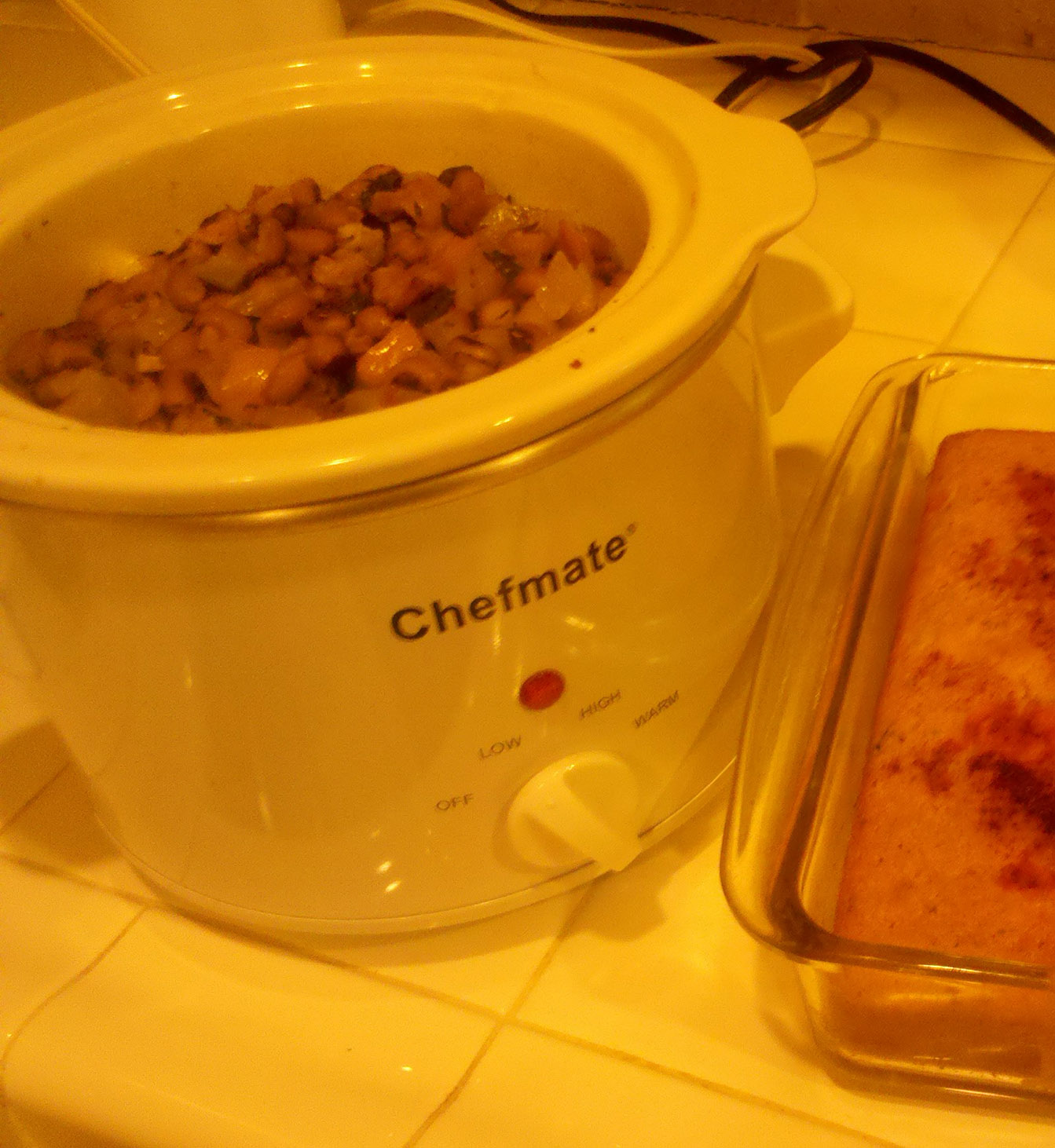 Warming my 2011 Black-eyed peas in the crock pot, with paprika dusted cornbread on the side